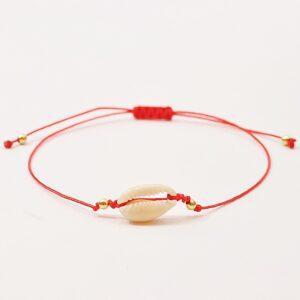 Bransoletka Mini Shell No2 - urocza,wykonana z nylonowego, cienkiego sznureczka z bardzo modną w tym sezonie maleńką muszelką Kauri.